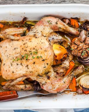 whole baked chicken with vegetables and thyme